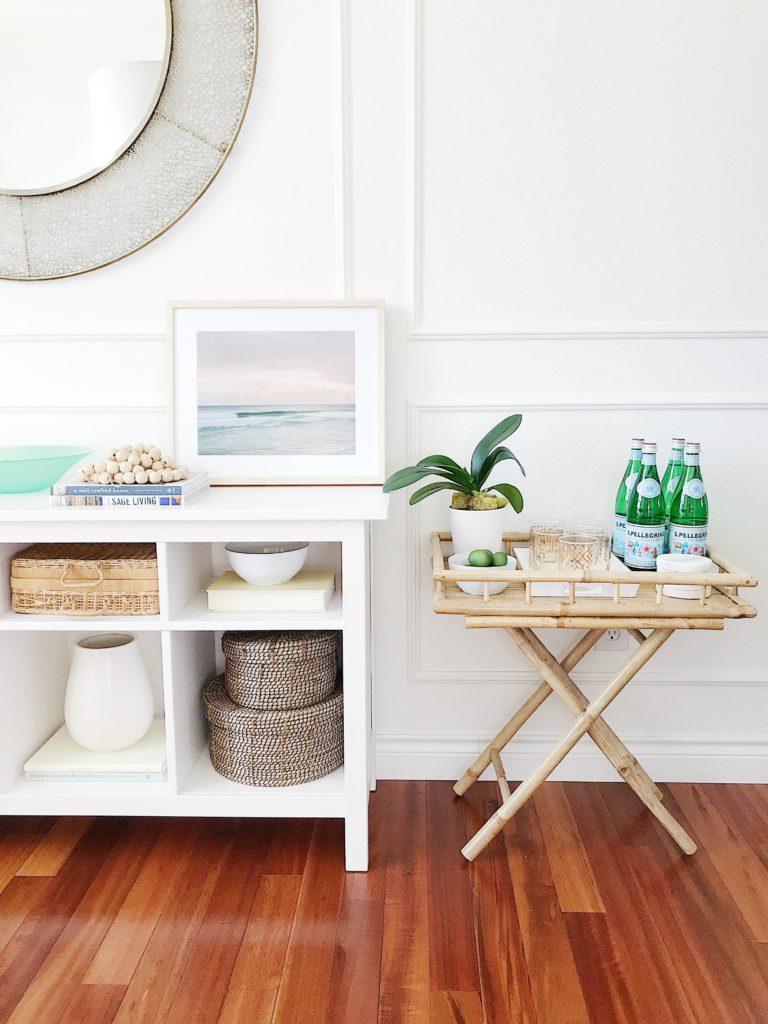 Dining Room With Bamboo Bar Cart Coastal Art White Walls Round Mirror