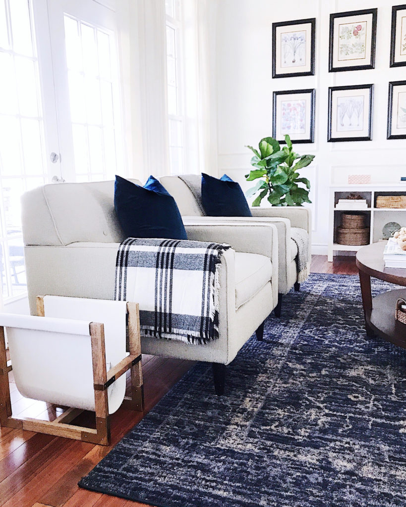 One of the best ways to create a cozy atmosphere in our home is with throws--especially when they're made of soft fabrics like cashmere or cotton. I like to keep throw blankets all over the house so I can easily wrap up whenever I get chilly. They're one of my favorite ways to make our living room feel cozy for winter #livingroomdecor