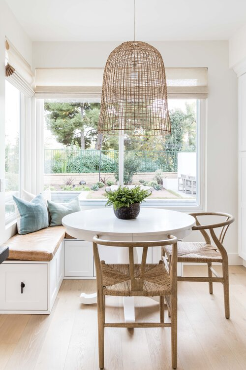 Beautiful breakfast nook idea for cozy kitchen dining with woven pendant light and wishbone chairs - Pure Salt Interiors #dining #breakfastnook #kitchennook #nook