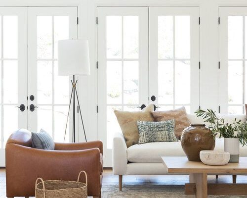 Loving lately -- this light-filled living room design, filled with layered textures and natural elements #livingroom #livingroomdecor