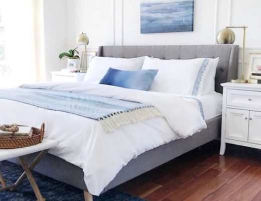 Calming blue and white master bedroom with coastal artwork and Serena & Lily bedding - jane at home #bedroomdecor #bedroomideas #bedroomdesign