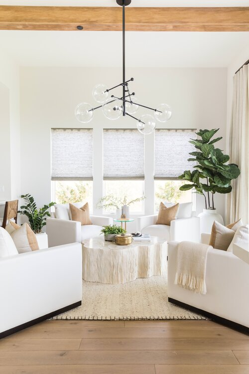 Modern coastal living room with four chairs around a coffee table | keeping room | sitting area | modern coastal decor
