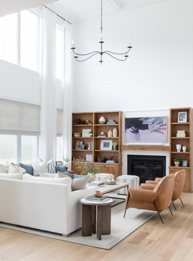 Beautiful modern living room design with built in shelves next to fireplace - living room ideas - modern living room design - Salt Design Co.