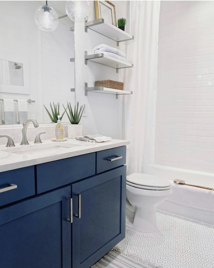 How I added a touch of modern coastal style to our guest bathroom - bathroom decor - bathroom remodel - small bathroom ideas - blue vanity - Benjamin Moore Van Deusen Blue