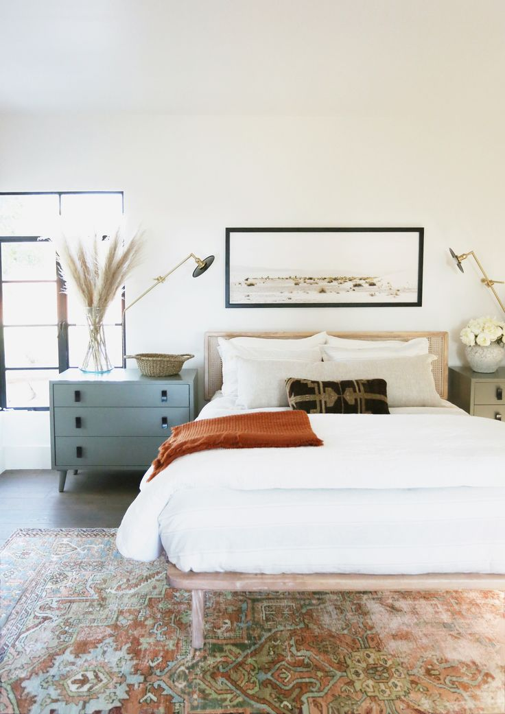 Modern bedroom design with rich, warm tones, cane bed, pampas grass and sconces - decor trends for 2021 - juniper home #home #style #design #decor #master #bedroom