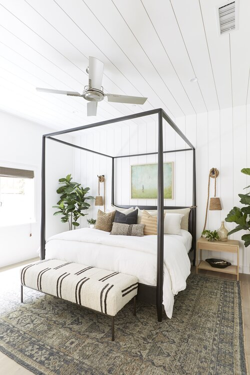 Beautiful neutral modern coastal bedroom with black canopy bed and striped bench - Pure Salt #interiordesign #bedroomdecor #bedroomdesign #modernbedroom #masterbedroom