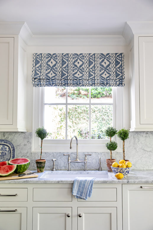 2021 Decor and Design Trends I Love: Beautiful blue and white kitchen idea with topiaries and custom Roman window shade - Clary Bosbyshell