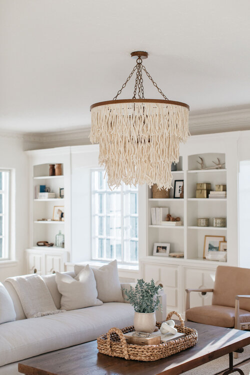 Beautiful light-filled living room with builtin shelves and beaded coastal chandelier - Kate Marker