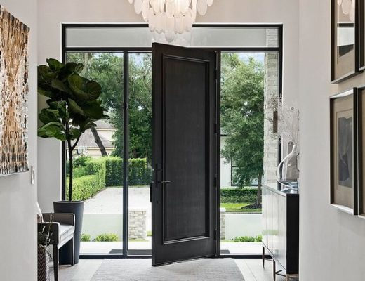 Beautiful modern entryway with black door framed in glass and beautiful chandelier - foyer - entryway ideas - modern home -M. Lahr Homes -