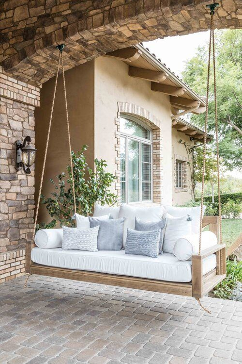 Beautiful home exterior and front porch with wood swing bed