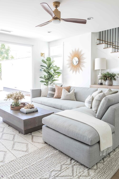 Such a beautiful living room -- I love the neutral furniture and decor and modern beach house style