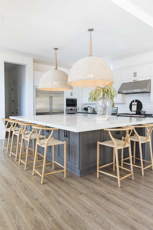Beautiful modern kitchen with large woven pendants and oversized kitchen island