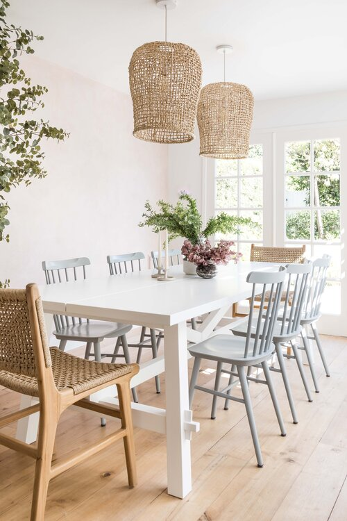 Beautiful modern dining room with woven pendant lights and beach house style