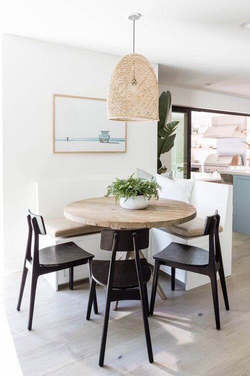 Love this little breakfast nook with its built in banquette seating and woven pendant light