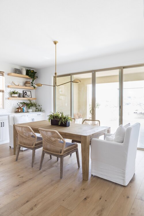 Beautiful modern dining room with woven side chairs