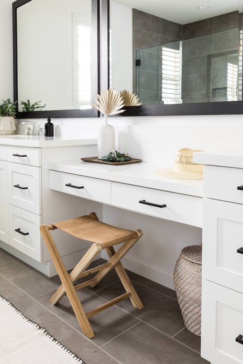 Master bathroom with sitting area and white cabinets with black hardware and mirrors - Pure Salt Interiors