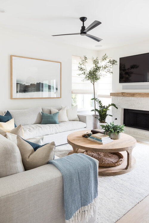 A contemporary living room with warm coastal style - living room ideas - transitional decor - modern living room - round coffee table