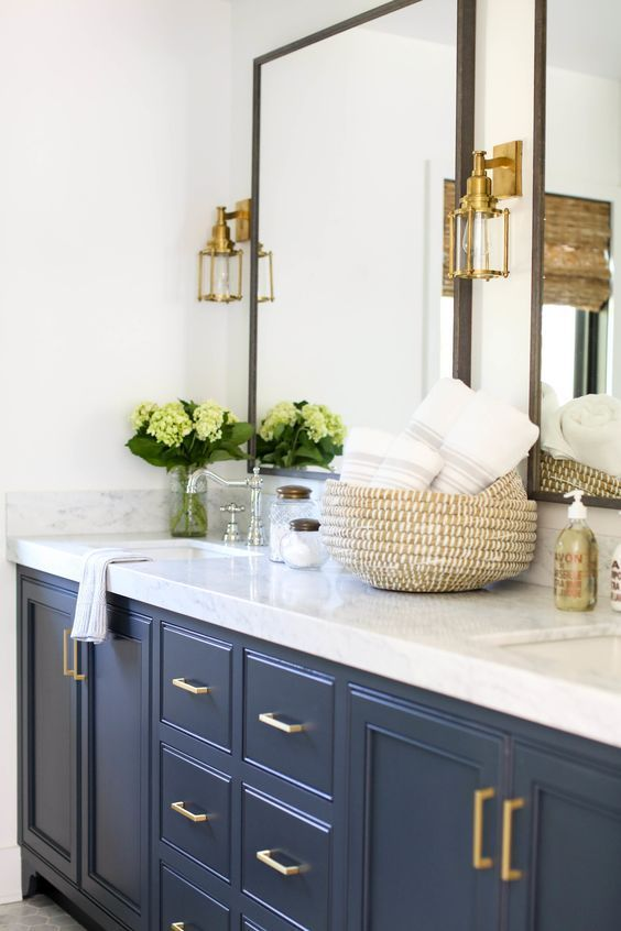 Beautiful modern master bathroom with dark blue vanity, marble countertop, and brass gold accents - bathroom remodel - bathroom design - bathroom decor