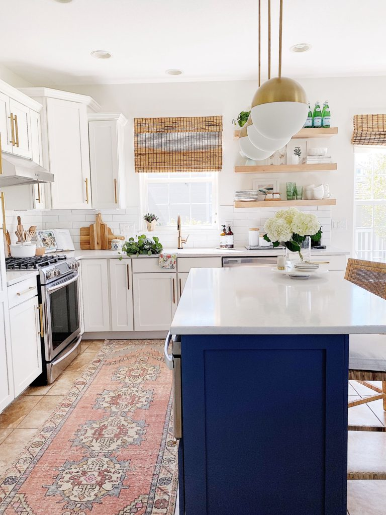 Organic textures, open shelving and touches of blue and white add a touch of modern coastal / beach house style to our kitchen - jane at home - kitchen remodel - kitchen decor - kitchen ideas