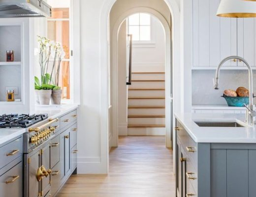 Gorgeous kitchen design with blue island and arched doorway - Marshall Erb Design