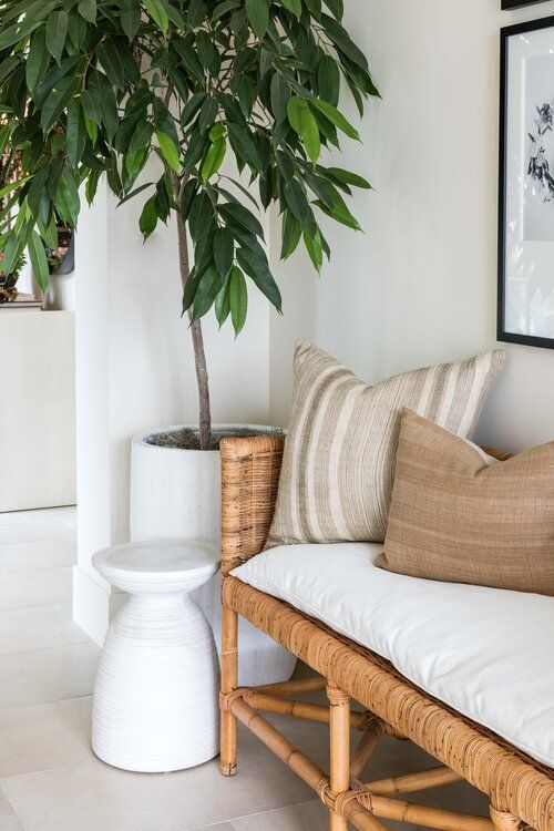 Beautiful modern entryway with woven bench, artwork, and neutral pillows - pure salt
