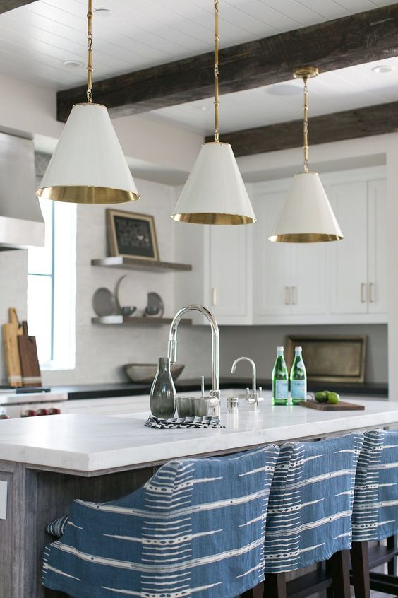 Love this beautiful kitchen design with blue and white slipcovered counter stools and white cone pendant lights over the island - approachable, everyday modern style - kitchen remodel - kitchen lighting - modern coastal kitchen - brooke wagner design