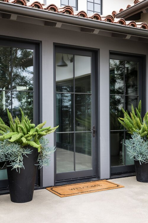 Beautiful modern exterior entrance and front door with black accents - iron ore sherwin williams