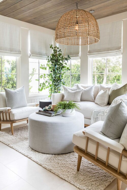 Beautiful modern living room with soft neutral colors and round ottoman - living room ideas - transitional living room