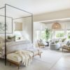 Beautiful open concept living room and kitchen withtwo mid-century modern chairs and organic modern coastal decor - Pure Salt